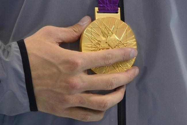 US swimmer Nathan Adrian holds his gold