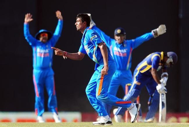 Indian cricketer Rahul Sharma (C) celebr