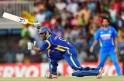 Sri Lankan cricketer Jeevan Mendis (L) p