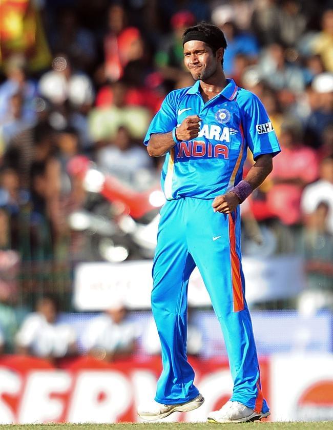 Indian cricketer Ashok Dinda celebrates