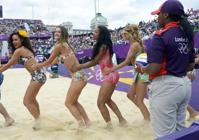 Cheerleaders perform a routine during a