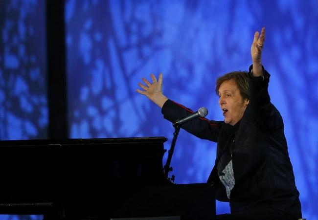 Musician Paul McCartney performs during the opening ceremony of the London 2012 Olympic Games at the Olympic Stadium