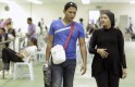 Pregnant Malaysian shooter Nur Suryani talks to husband after competing at 36th Southeast Asian Shooting Championship 2012 in Subang