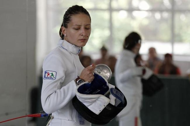 Romanian fencer Branza checks her sword during Romania