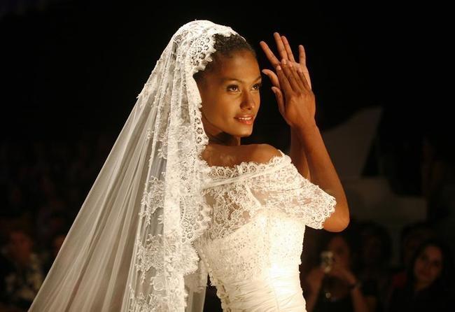 A model presents a wedding creation by Geraldina Sposa during a fashion show in Tirana