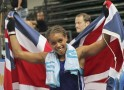 Jonas of Britain holds a British national flag as she celebrates after defeating Egner of Norway at the AIBA World Women
