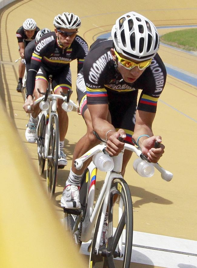 Juan Esteban Arango of Colombia trains for his track cycling event for the upcoming London Olympics, at the velodrome in Medellin