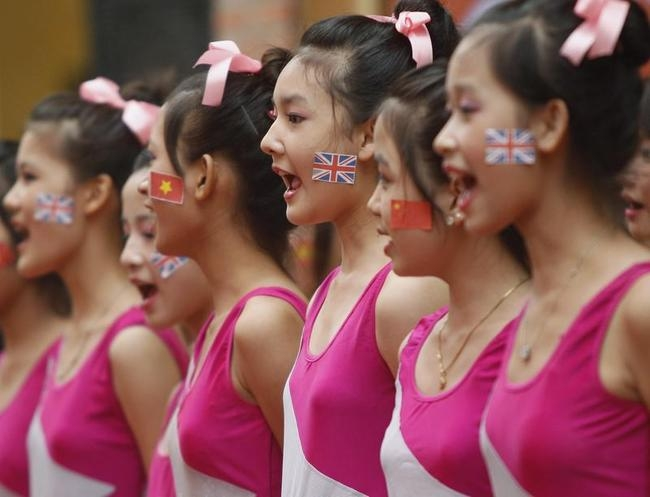 """Students participate in the """"Power Of The Games"""" festival, which is part of Big Dance 2012, ahead of the London 2012 Olympics at a school in Hanoi"""