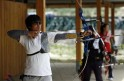 Bhutan archer Sherab Zam prepares to shoot during a training session at Lhangjophakha on the outskirts of Thimphu