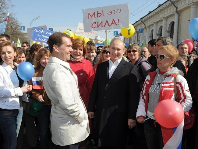 Russian President Dmitry Medvedev (2nd L) and the president-elect and Prime Minister Vladimir Putin (2nd R)