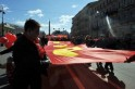 Russian communist party supporters carry a gaint red flag during the May Labour Day rally