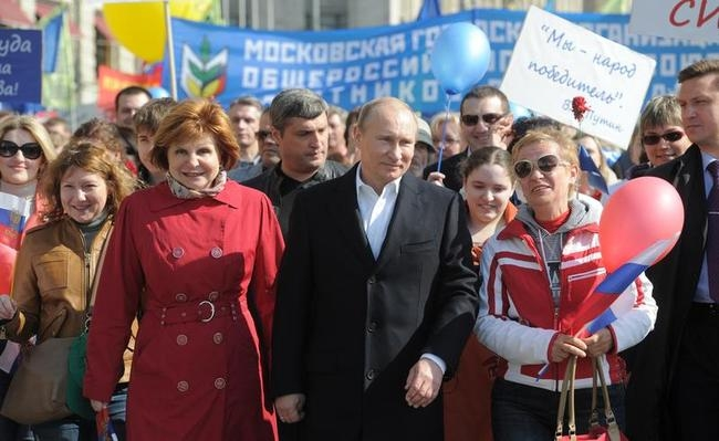 The Russian president-elect and Prime Minister Vladimir Putin (C) attends the May Labour Day rally