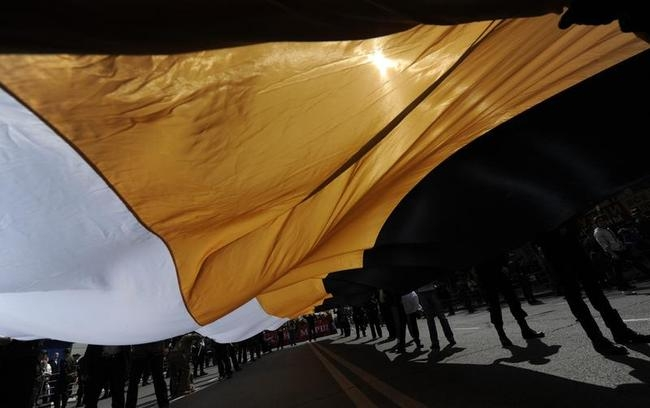 Nationalists carry a huge black-yellow-white flag of the Russian Empire during the May Labour Day rally