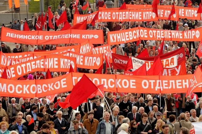 Russian communist party supporters hold red flags and posters during the May Labour Day rally