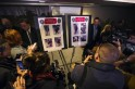 Members of the media photograph images released by investigators of suspects in the two explosions during the Boston Marathon, at a news conference in Boston