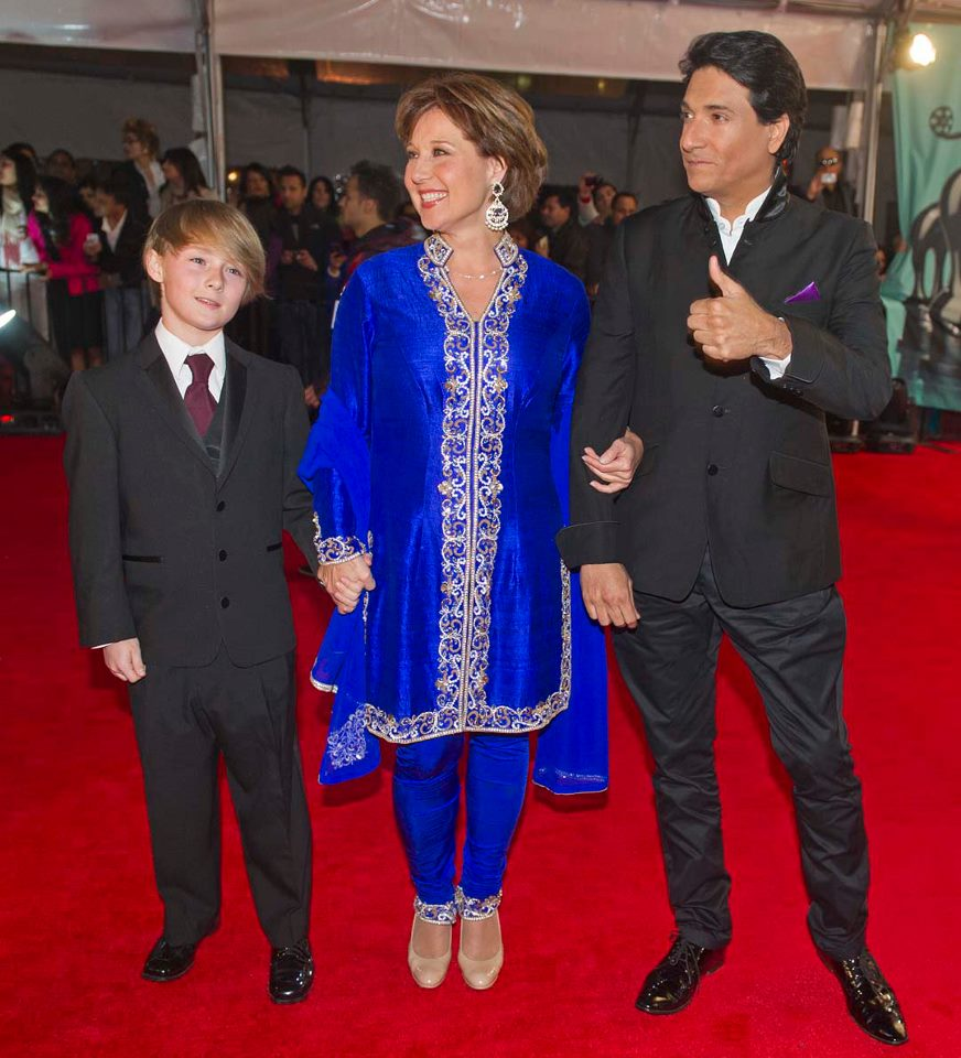 B.C. Premier Christie Clark arrives with her son Hamish and Shiamak Davar
