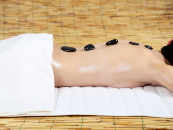 massage therapy: Massages to De-stress Yourself: Heated Volcanic Hot stone massage