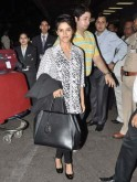Asin with a Fendi bag