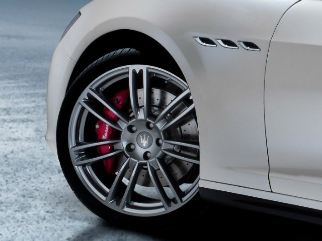 The design details include portholes on the sides, trident badging and sculpted lines