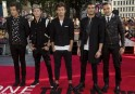 "One Direction pose for photographers at the world premiere of their film ""One Direction: This is Us"", in London"