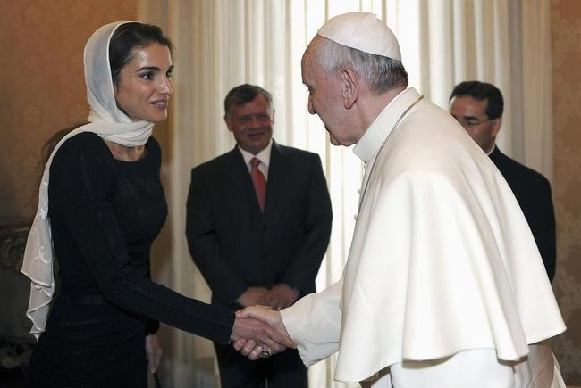 Pope Francis shakes hands with Jordan
