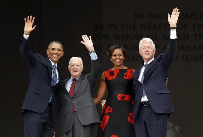 Obamas, Carter and Clinton wave during the 50th anniversary of the March on Washington