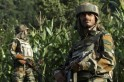 Indian army soldiers patrol near the Line of Control, a ceasefire line dividing Kashmir between India and Pakistan, in Poonch