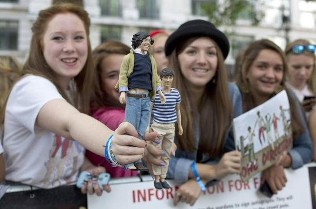 "One Direction fans wait for the premiere of the film ""One Direction: This is Us"", in London"