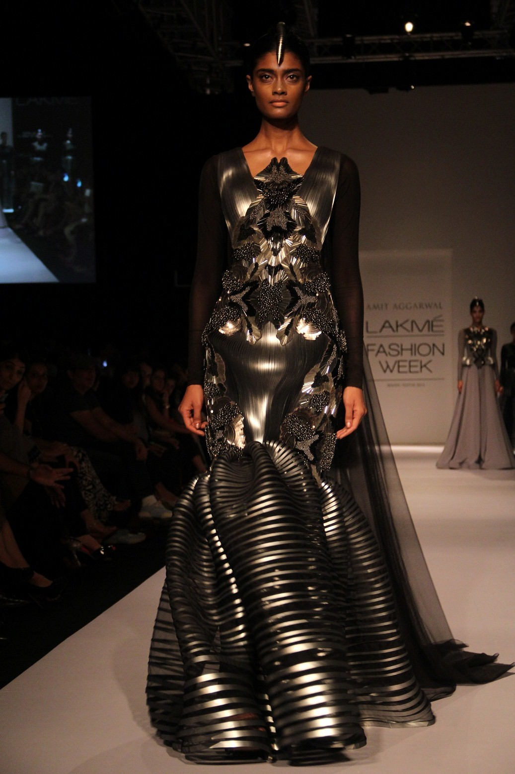 design detailing. At Lakmé Fashion Week Winter/Festive 2013, Amit Aggarwal's collection seen in Mumbai for the first time, inspired by architectural structures was a mind-boggling line. Each garment was hand sewn with minute detailing of moulding,