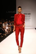"""August 2013: Adding controlled Boho chic to her collection called """"Eccentricity Tour"""", Nupur Kanoi was inspired at the Lakmé Fashion Week Winter/Festive 2013 show by the decadent 70's era when music and flower-power madness was the rage. The li"""
