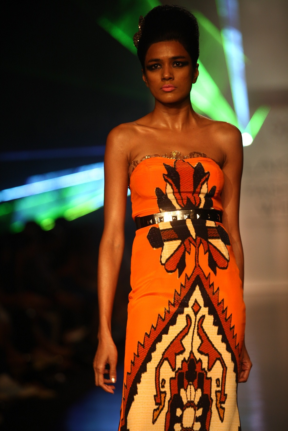 """August 2013: DHL presented the vibrant festive holiday collection by Pria Kataaria Puri called """"Fast and Curious"""" at Lakmé Fashion Week Winter/Festive 2013. Against a backdrop of a multicolor laser show, the models strutted down the ramp in itsybi"""