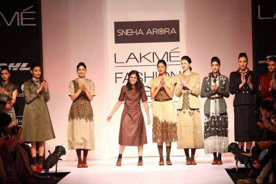 "Sneha Arora let her imagination revolve around a Vintage Military theme for her collection called ""A Soldier Story"" at Lakmé Fashion Week Winter/Festive 2013. It was a disciplined range with a marked regimental look that revealed a hint of stark dete"