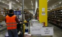 A worker is pictured at his working place at the warehouse of Amazon