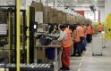 Workers handle items for delivery at Amazon