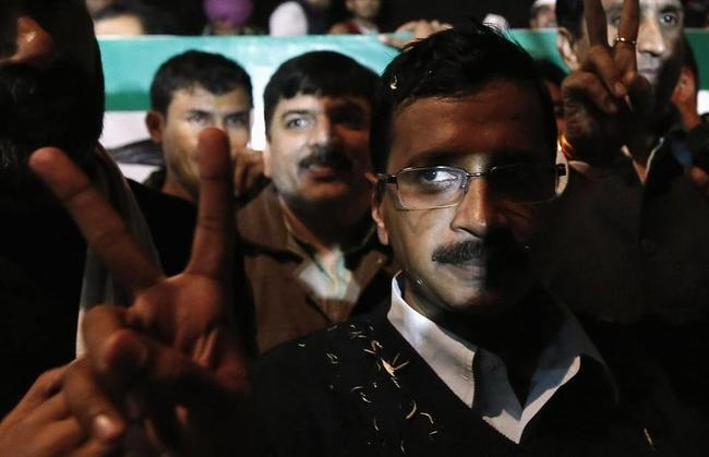 Kejriwal, leader of Aam Aadmi (Common Man) Party, gestures after addressing media after his election win against Delhi CM Dikshit, in New Delhi