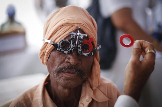 A man gets his eye tested at a free eye-care camp