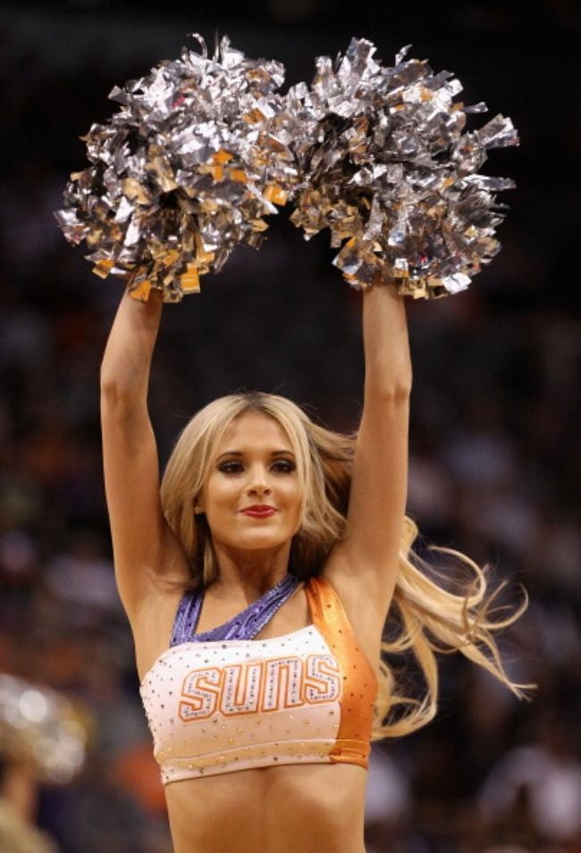 A Phoenix Suns cheerleader performs during the NBA game against the San Antonio Spurs