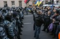 Police stand guard in front of protesters during a demonstration in support of EU integration in front of the Parliament building in Kiev