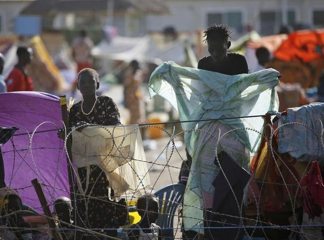 Internally displaced people stand inside a UNMIS compound in Juba
