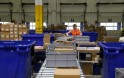 Worker handles items for delivery at Amazon