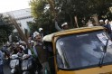 Supporters of the newly formed Aam Aadmi Party, hold brooms and shout slogans during a rally in New Delhi