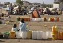 Internally displaced children wait for water inside a UNMIS compound in Juba