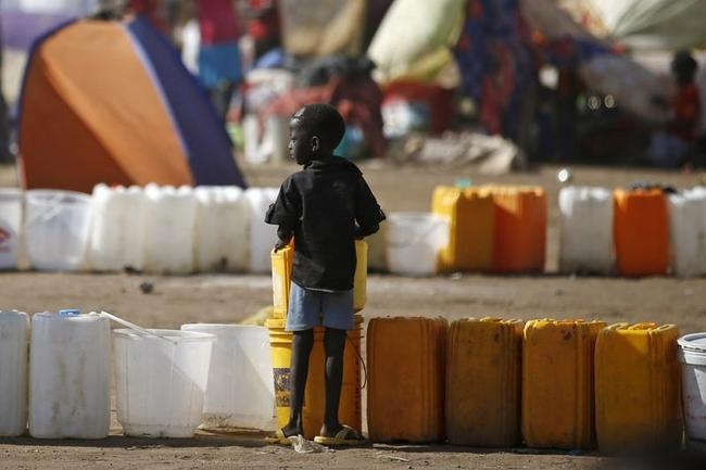 An internally displaced boy waits for water inside a UNMIS compound in Juba