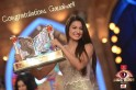 Gauahar Khan Wins Bigg Boss 7 and poses with her Bigg Boss trophy.