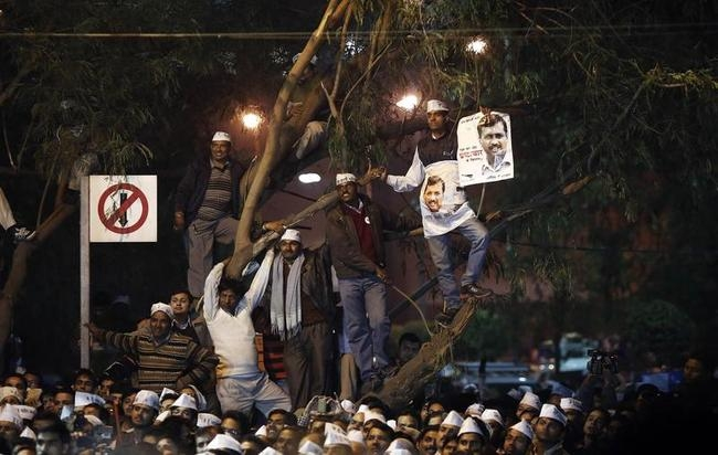 Supporters of Kejriwal leader of the newly formed Aam Aadmi (Common Man) Party listen to a speaker during their first party workers