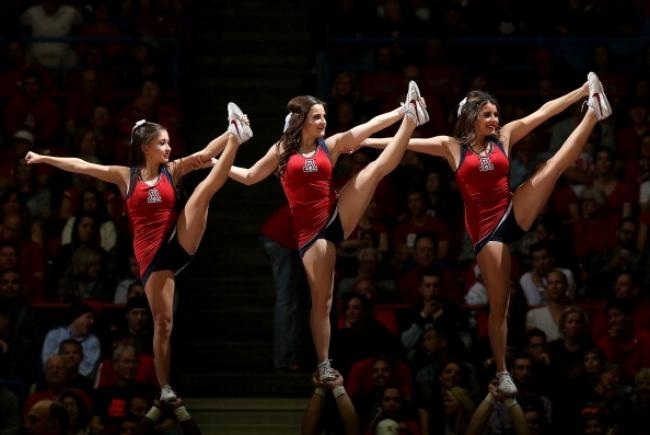 The Arizona Wildcats cheerleaders perform during the college basketball game