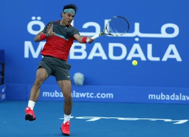 Rafael Nadal of Spain hits a return to compatriot David Ferrer in Abu Dhabi