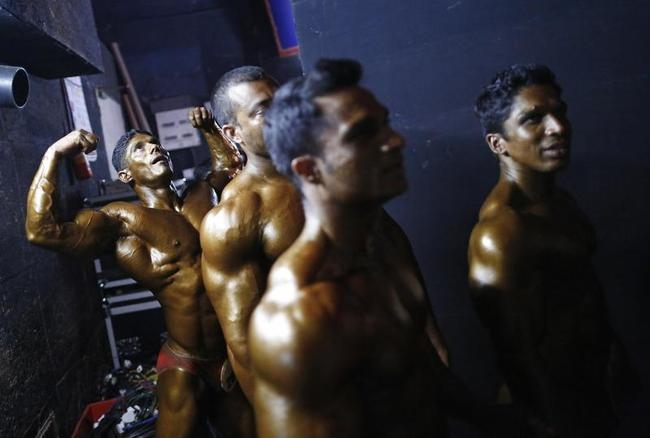 Competitors wait to get on the stage during a bodybuilding competition in Mumbai