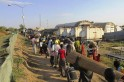 Civilians arrive for shelter at the United Nations Mission in the Republic of South Sudan compound in Bor, South Sudan