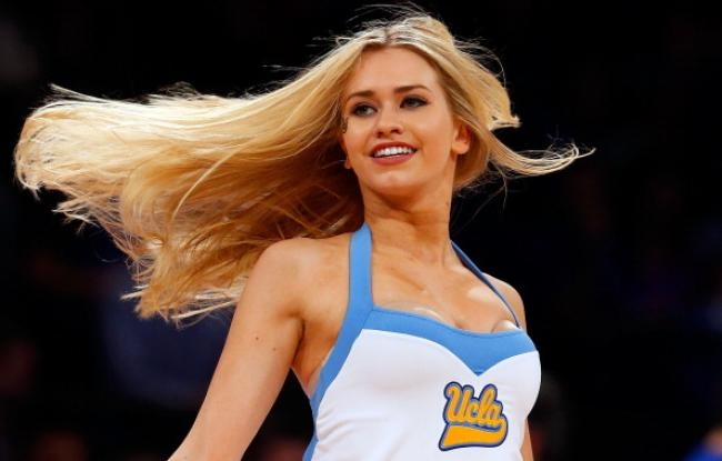 A UCLA Bruins cheerleader perfoms during a timeout against the Duke Blue Devils